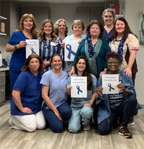 Teammates wear blue in recognition of Colorectal Cancer Awareness